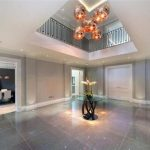 Large reception room with gold lights and marble floor