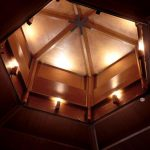 Gymnasium wooden roof with lighting by Sam Coles Lighting