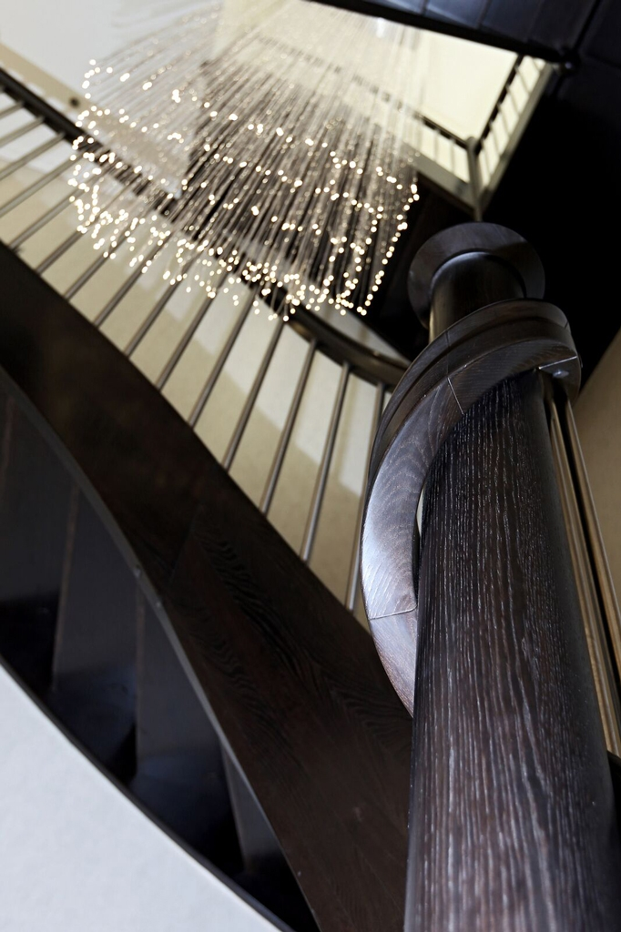 Fibre optic light chandelier on stairway