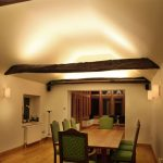 Diningroom lighting with beams by Sam Coles Lighting 06