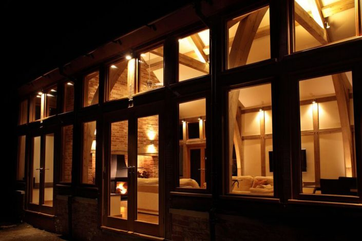 Wood framed room with lights on from outside