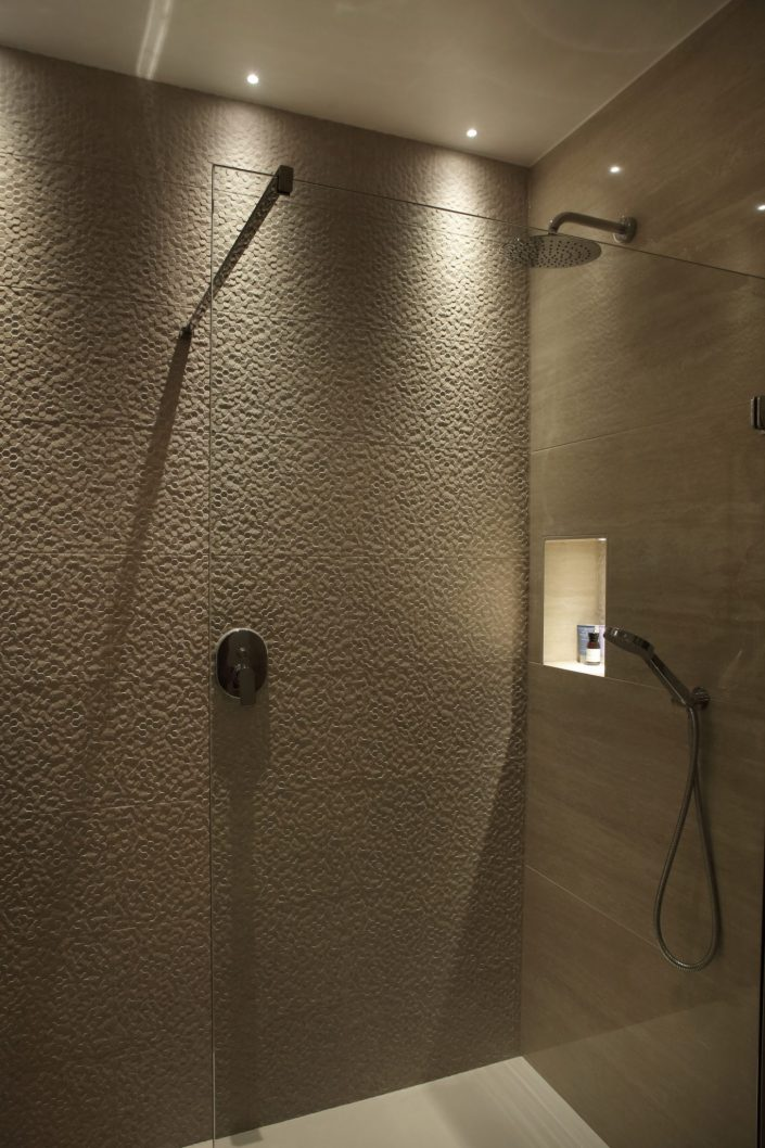 Illiminated alcove and downlights in shower