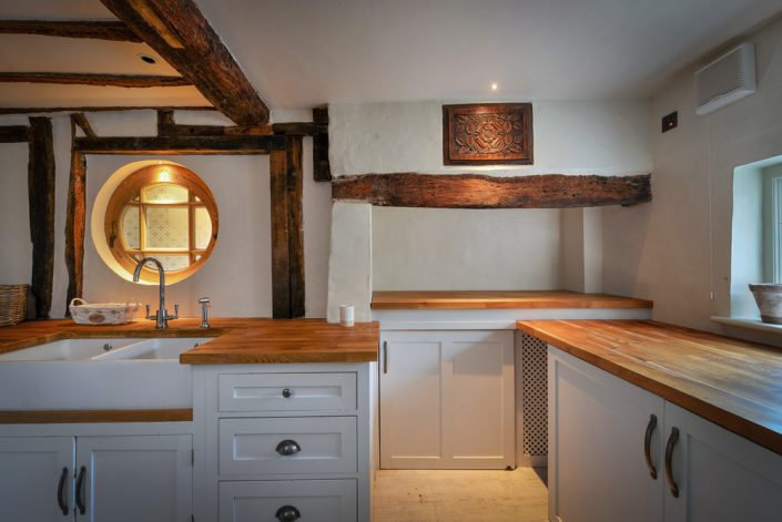 Wooden plaque on kitchen wall
